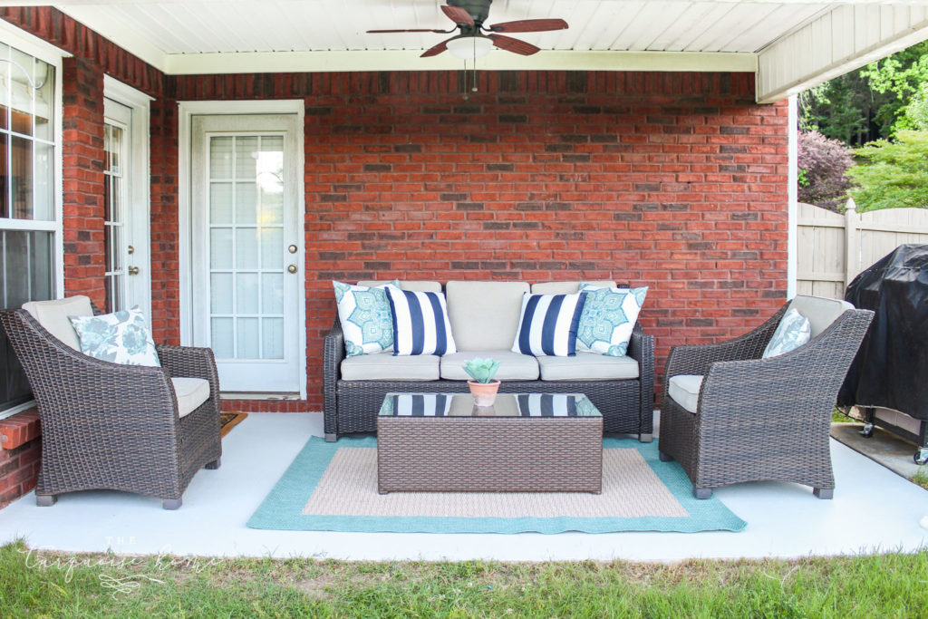How to Paint a Concrete Patio - with full chairs and rug in it after it was painted