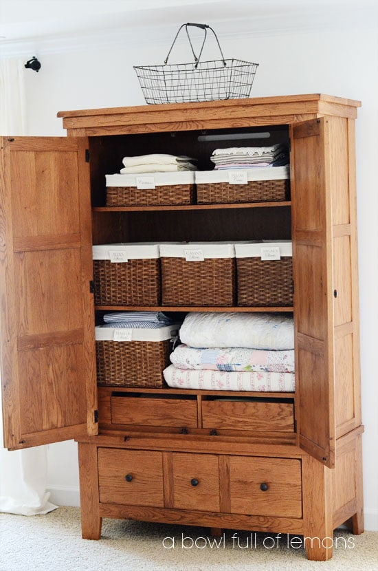 Top Linen Organization tips from A Bowl Full of Lemons | large armoire used as a linen closet