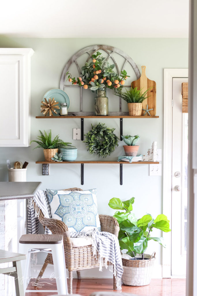 A Simple Peachy Summer Kitchen with gorgeous open shelves, turquoise plates, peach stems and fiddle leaf fig