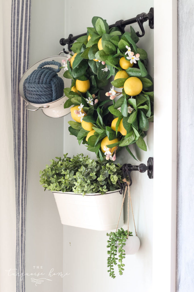 Simple Summer Kitchen Tour with a lemon wreath, white colander and summer greenery