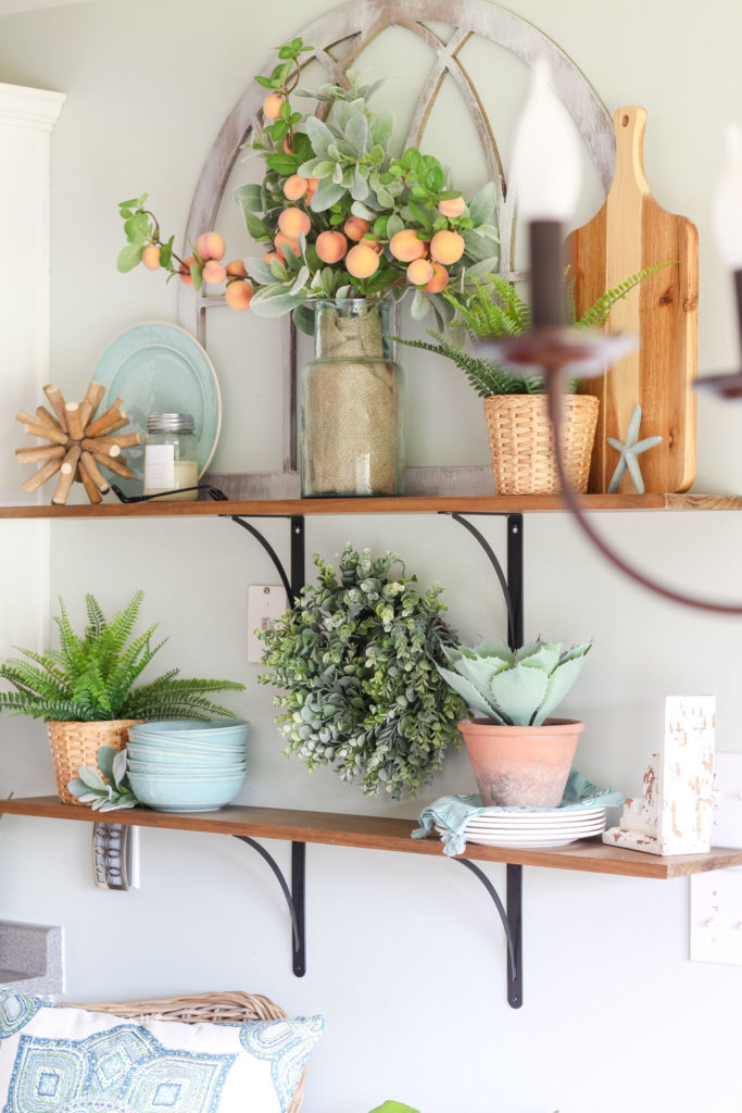 Open Kitchen Shelves Decorated for Summer - peach stems, turquoise dishes and lots of greenery