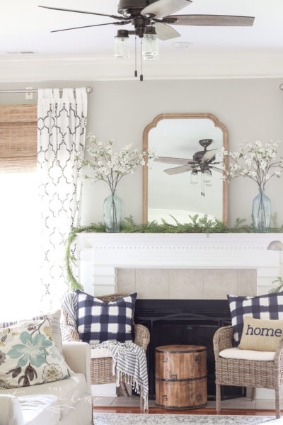 A Simple Summer Mantel -->> wood frame, white mantel, plaid navy pillows, jute bamboo blinds