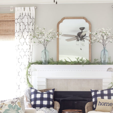 A Simple Summer Mantel -->> wood frame, white mantel, plaid navy pillows, jute bamboo blinds