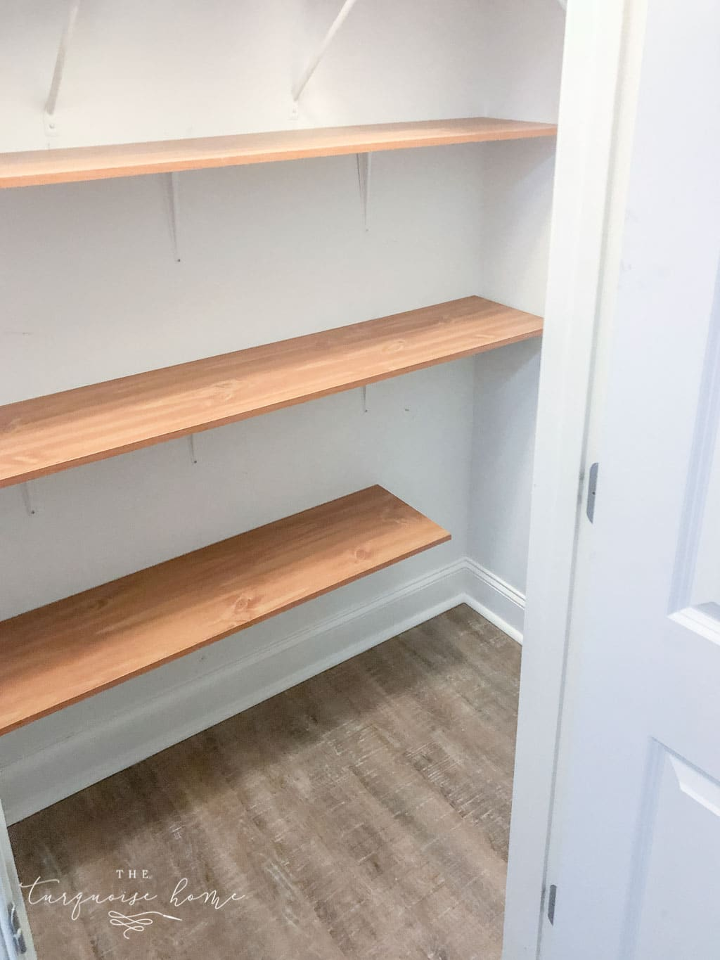 Utilize vertical space in a closet to make a DIY Pantry space!