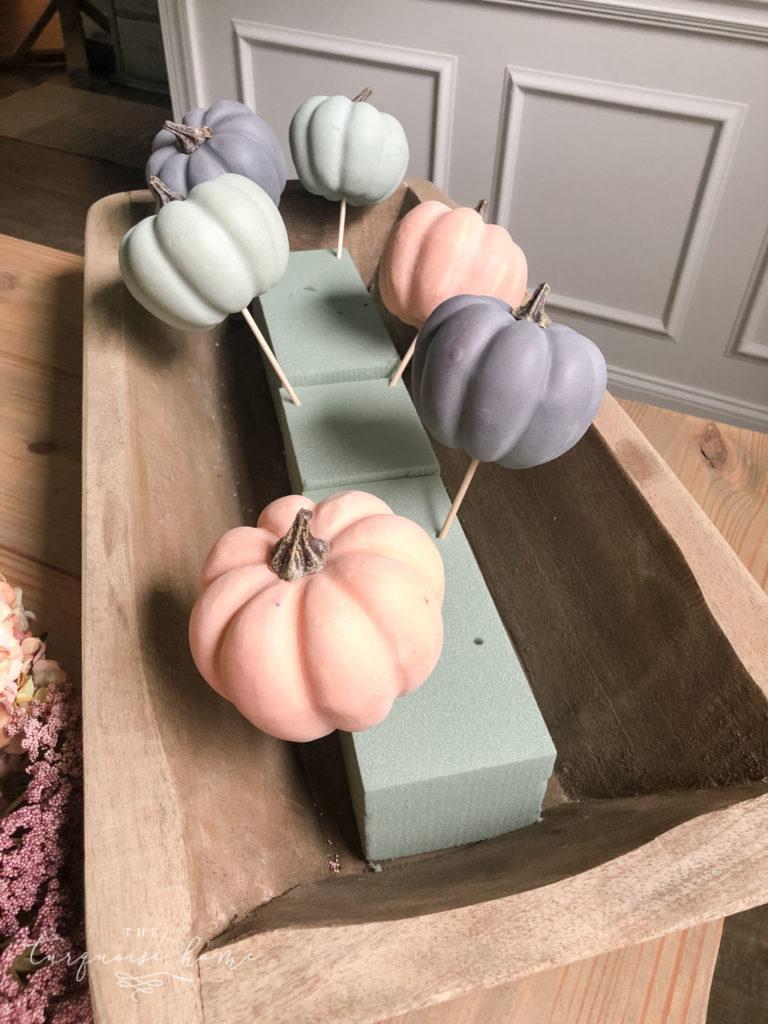 DIY Pumpkin & Dough Bowl Floral Fall Centerpiece - full tutorial | Add the largest pumpkins to the floral foam first