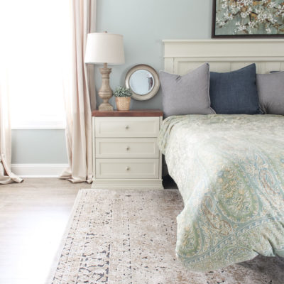 Gorgeous Ivory and Beige Antique-style Rug in a Farmhouse Master Bedroom. What size rug to buy for a king bed?