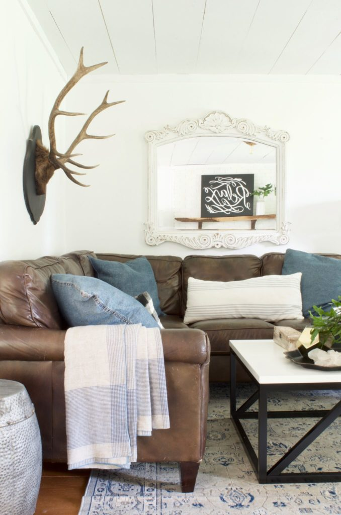 How to Decorate a Living Room - mirror behind the sofa