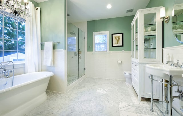 Wythe Blue painted walls with marble floors. Gorgeous bathroom design!