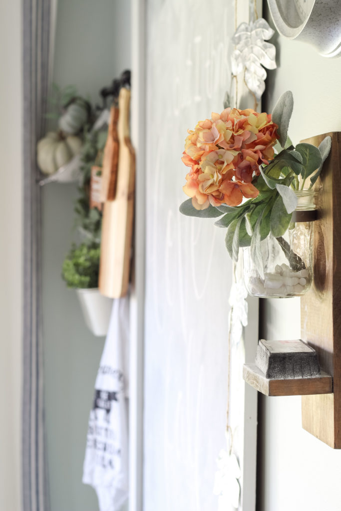 Chalk holder next to a chalkboard with a coral hydrangea for fall! Fall Home Tour | Fall Home Decor Ideas