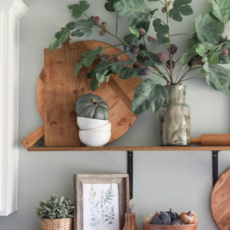 Open kitchen shelves decorated for fall | fig leaves | fiddle leaf fig | cutting boards | antique pizza boards | fall decor ideas