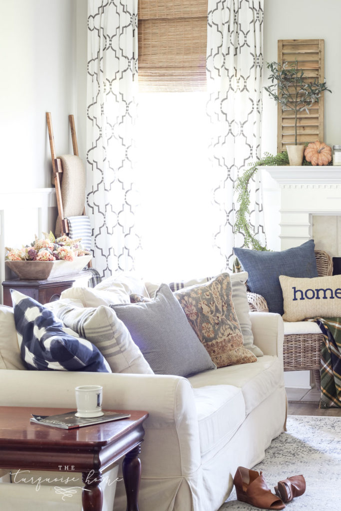 Fall Living Room Decor with mantel with wood shutter decor and browns and blues.