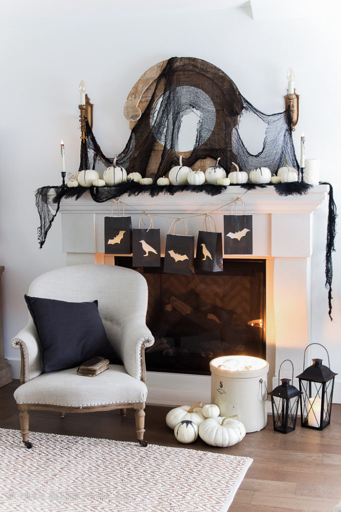 Classic black and white touches make this Halloween mantel decor super affordable and easy to achieve!