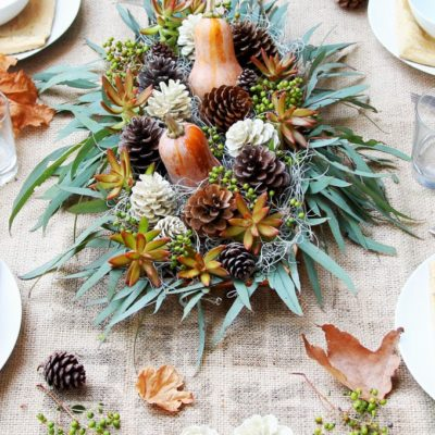 Thanksgiving table decor ideas - pinecones and gourds use nature to decorate the Thanksgiving dinner table