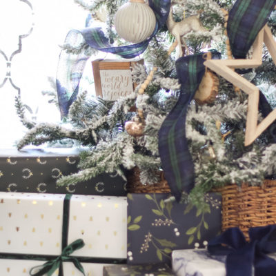 Beautiful blues and greens in the wrapping paper coordinate perfectly with the Christmas decor! Flocked Christmas Tree with Navy and Green plaid ribbon