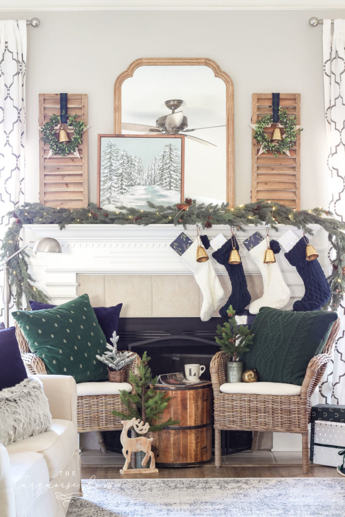 Green and Navy Simple Christmas Mantel - wicker chairs flanking a mantel