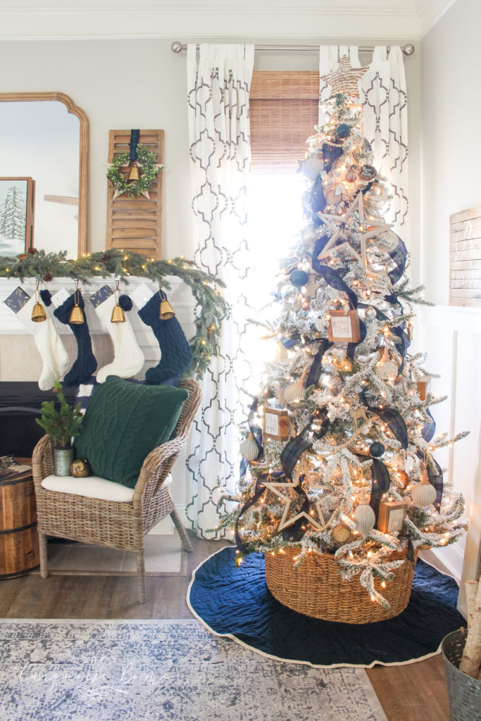 Pretty Christmas tree with flocking and neutral ornaments and navy and green decor!