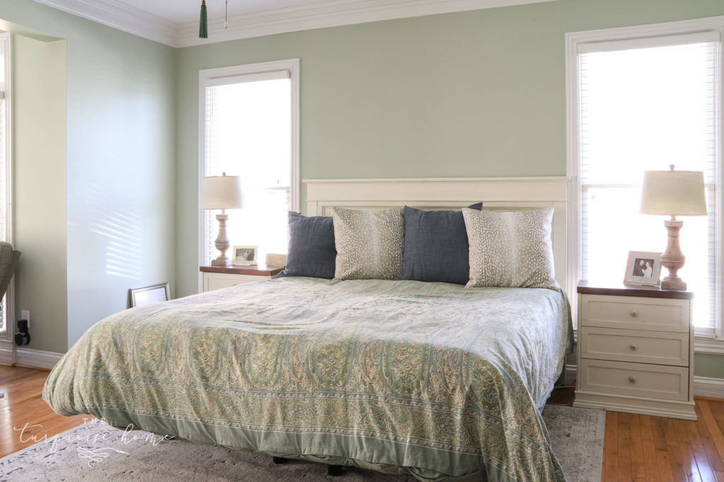 Master bedroom with pistachio green walls.