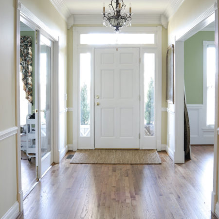 Entry way in new house with brown hardwood floors.