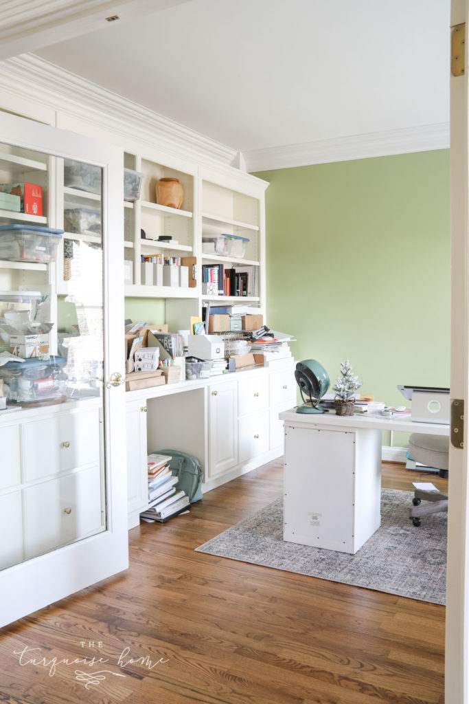 Lime green feminine office with built-in bookshelves.