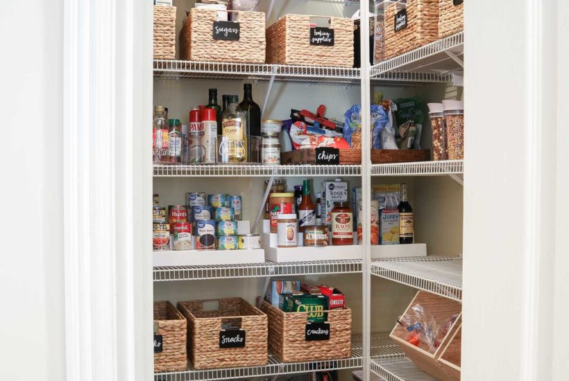 A decluttered and organized pantry with hyacinth baskets and wire shelving