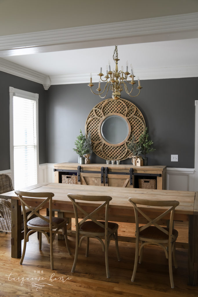 Benjamin Moore Kendall Charcoal in the Dining Room | A dark and moody dining room with white trim and brass & wood accents