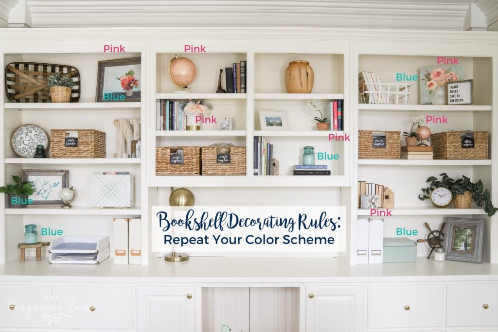 White built-in bookshelves with pink and blue decor | How to Decorate a Bookshelf
