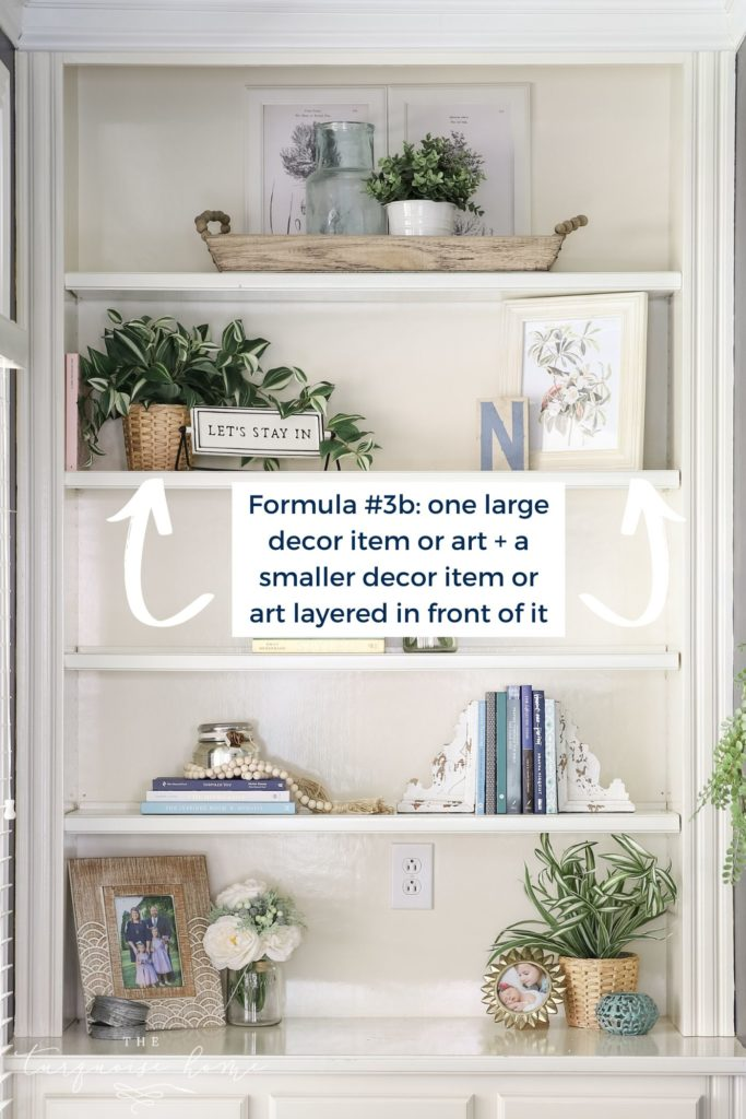 White built-in bookshelves with greenery, art and books!