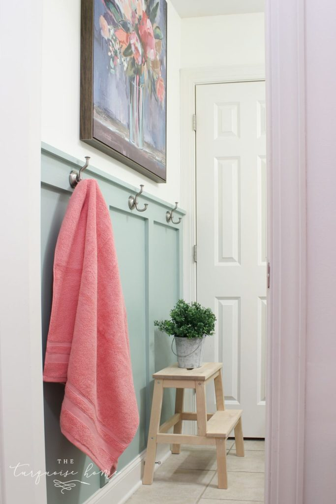 Farmhouse bathroom with hooks for towels