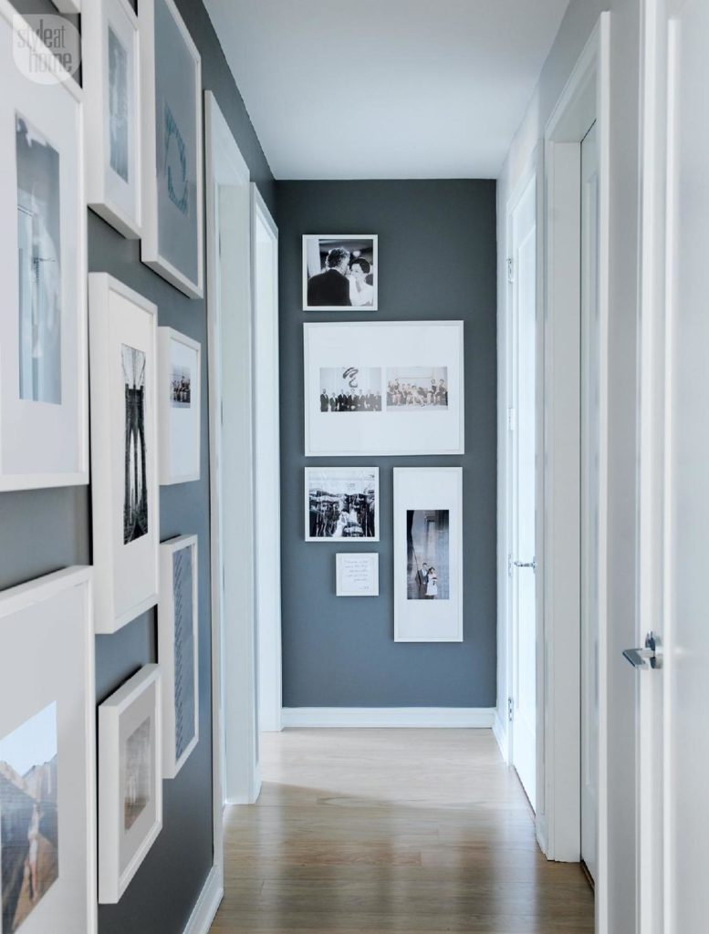 hallway decor ideas include creating a gallery of personal photos like this hallway