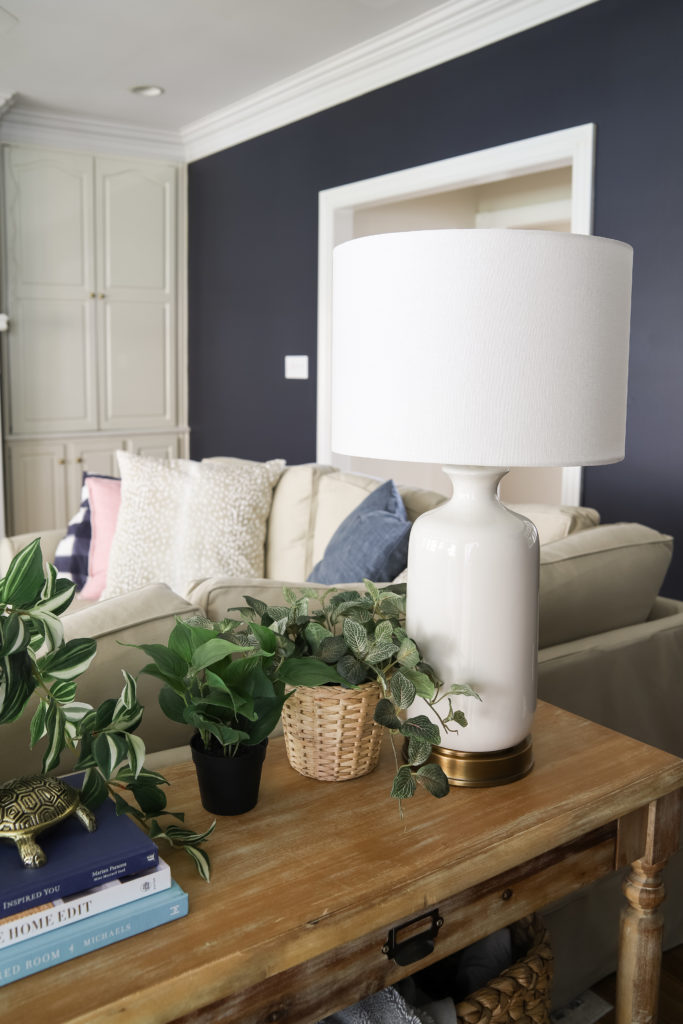 White USB Lamps and Faux Plants and Wooden Console Table
