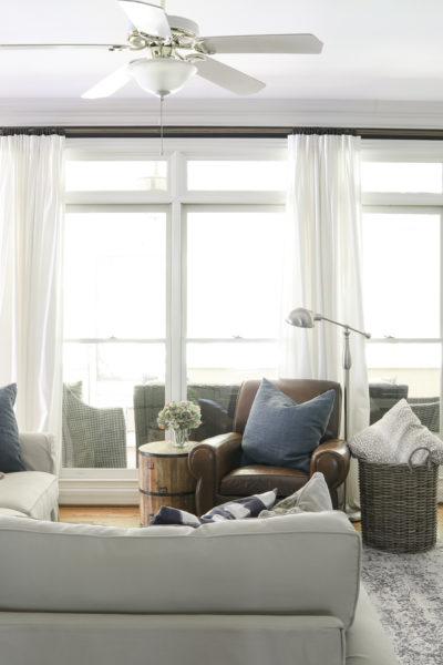 Inexpensive long curtain rods cover wall of windows