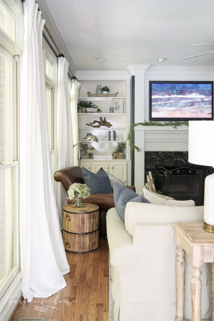 window draperies in navy living room
