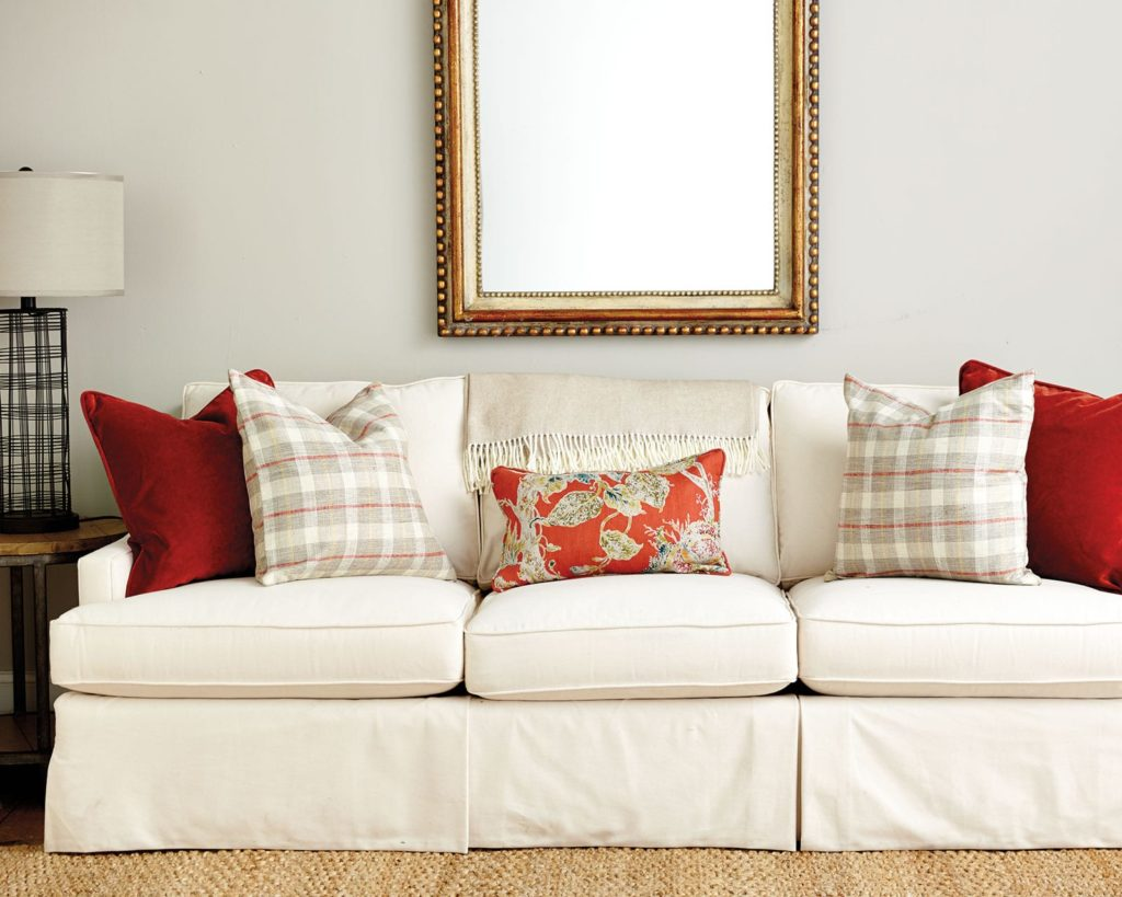 cream colored couch with multiple throw pillow sizes