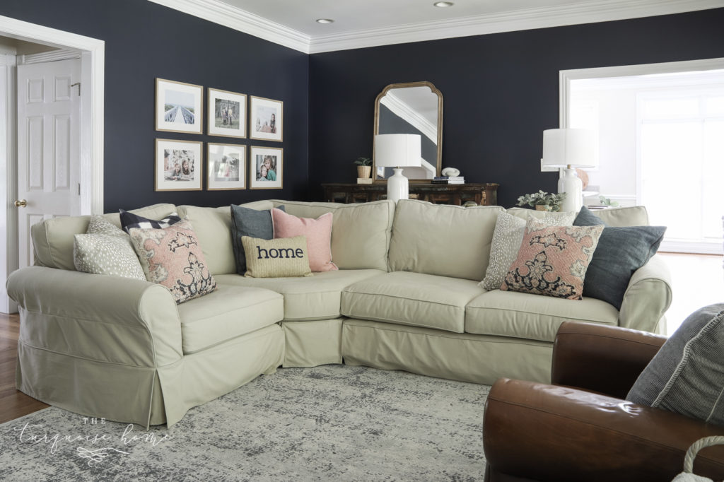 Sectional sofa in living room with throw pillows