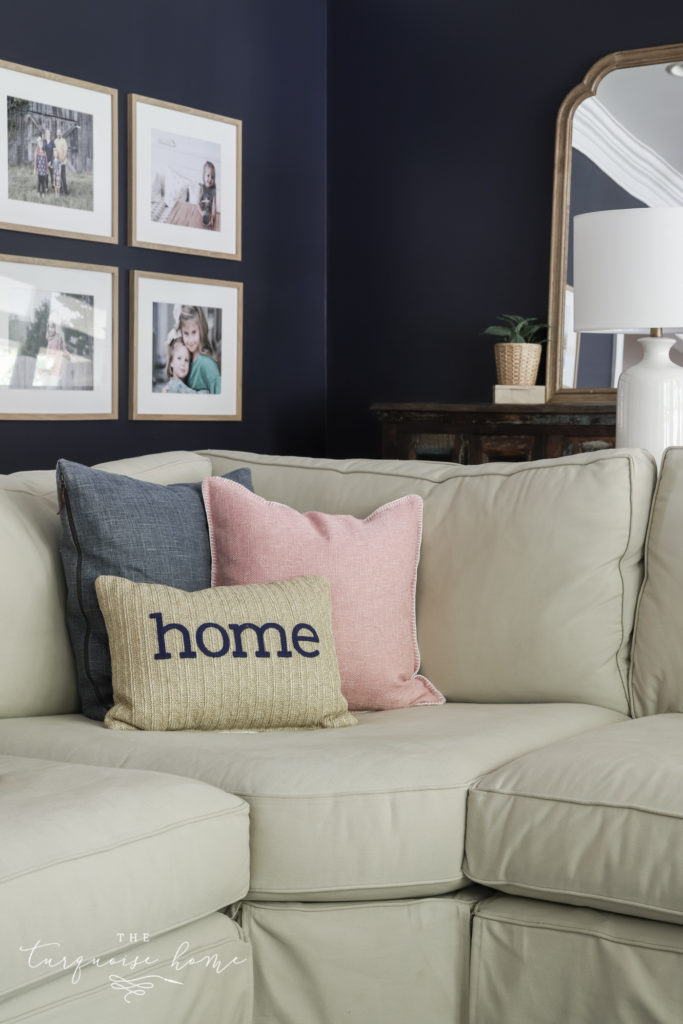 Two large square pillows with a bolster pillow in front