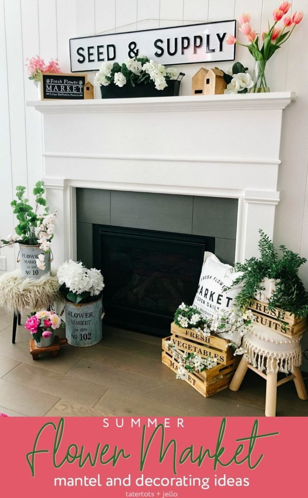 a wide sign and jars of flowers on a fireplace mantel