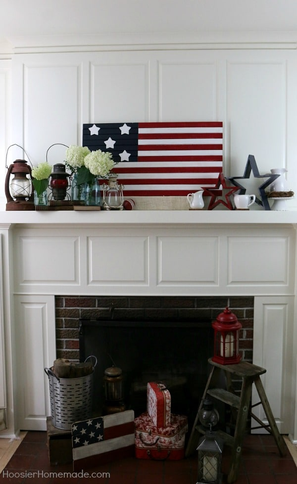 red, white, and blue stars and stripes mantel decor with white hydrangea blooms