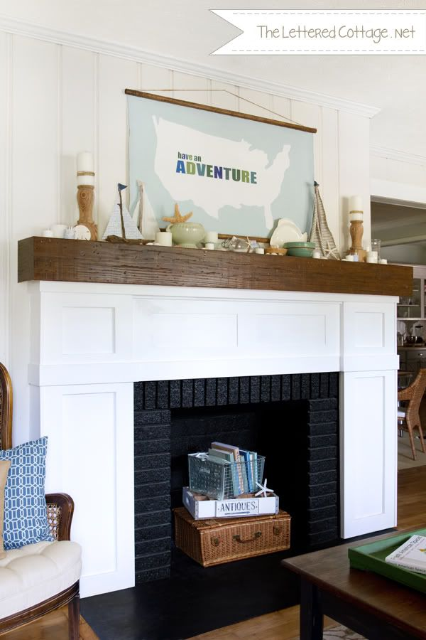 beach inspired fireplace mantel decor with shells and boats