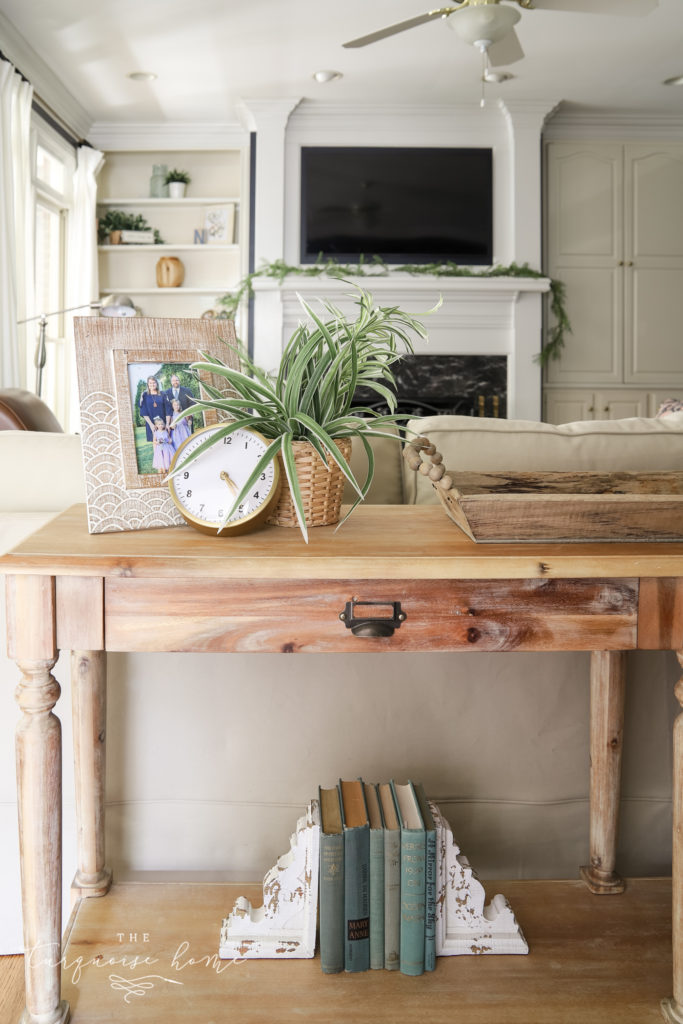 Styled Sofa Table Behind a Couch