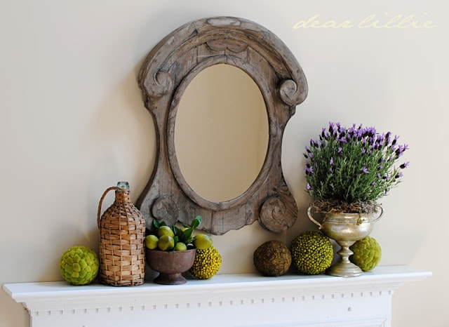 rustic farmhouse mirror with limes and potted lavender mantel decor