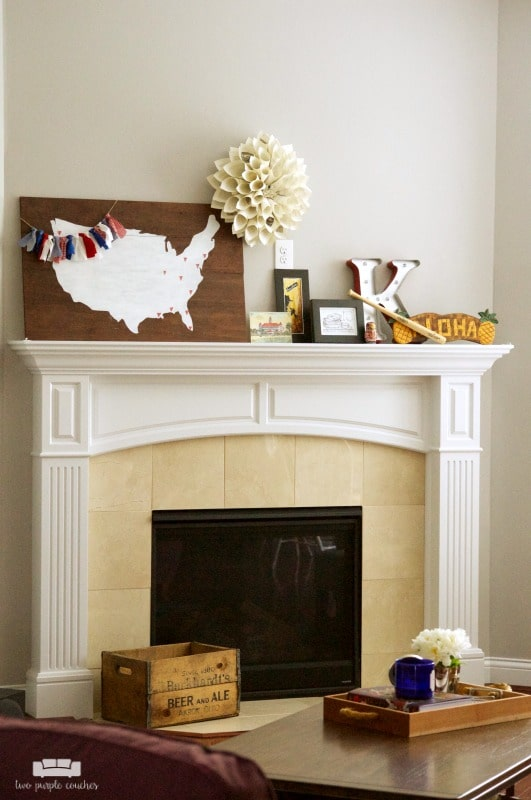 summer fireplace decor with map and travel souvenirs