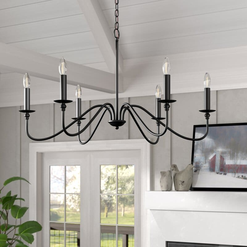 traditional candle style chandelier hanging from a ceiling