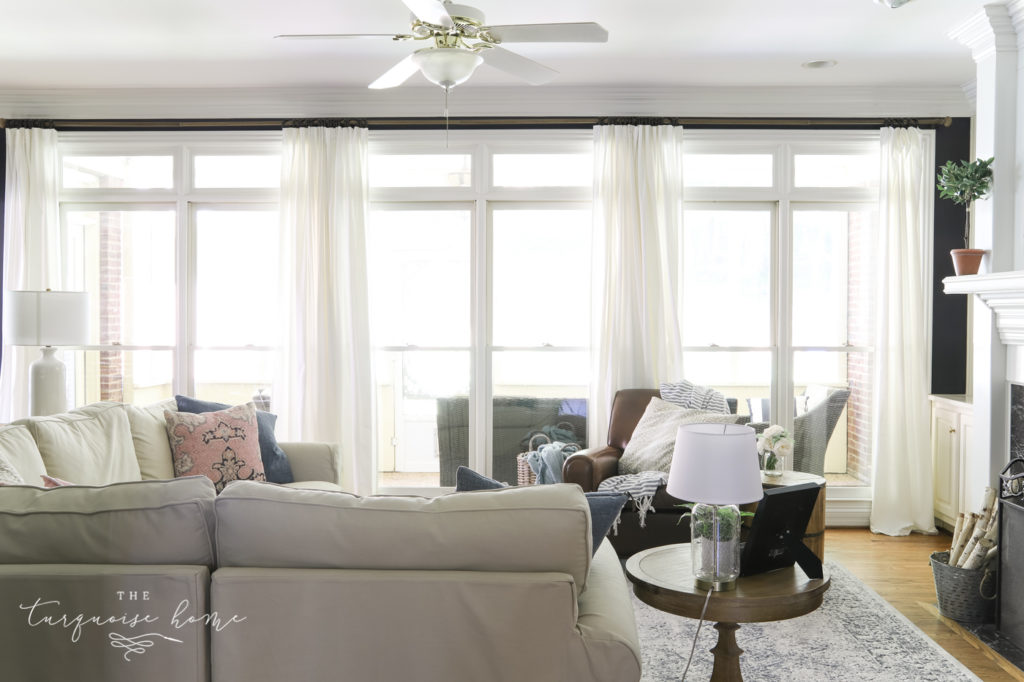 White curtains and wall of windows
