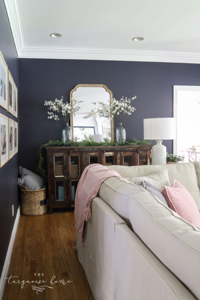media console with large mirror