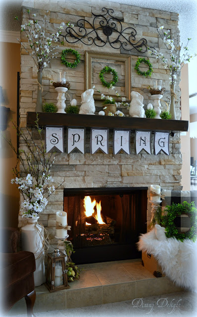 spring fireplace mantel decorations with spring garland sign, rabbit figures, candles and faux boxwood wreaths