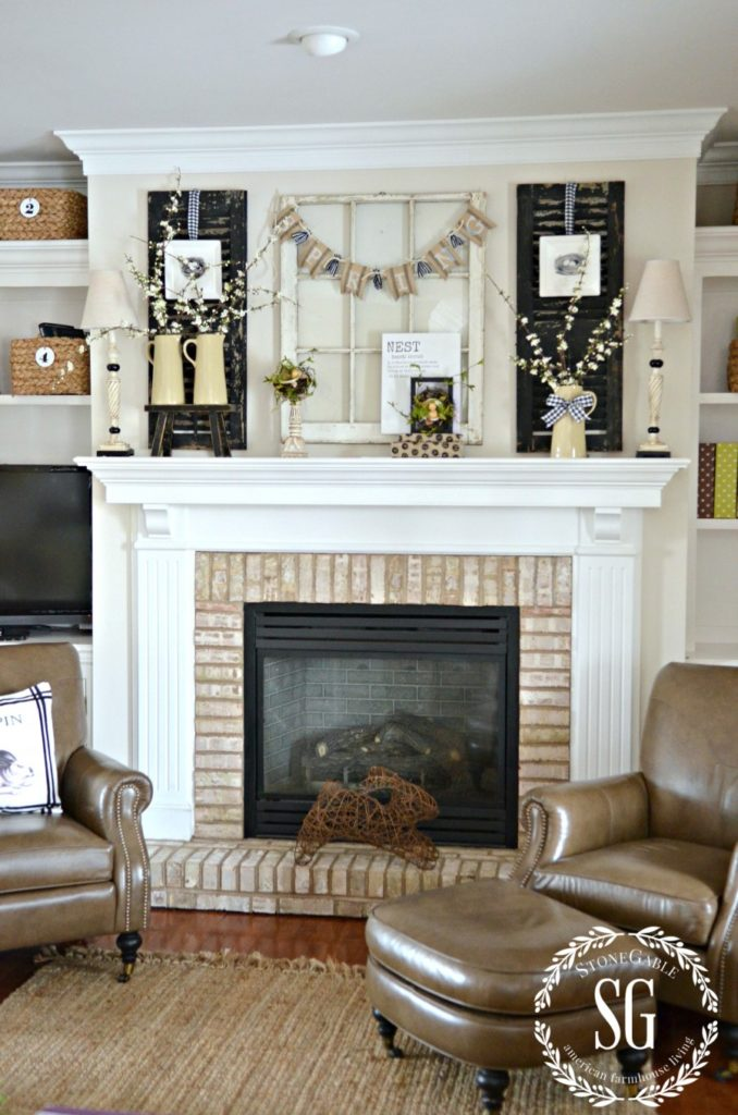 neutral spring mantel decor with candles, pitchers, and florals