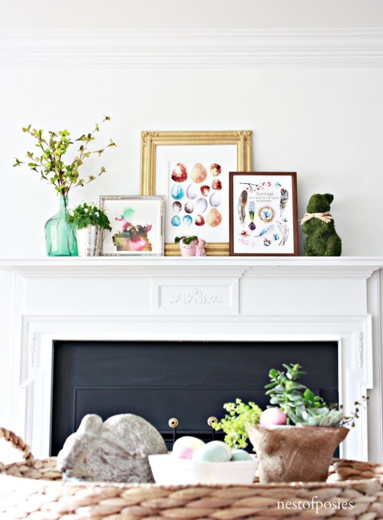 spring mantel decorations with colorful framed images and florals
