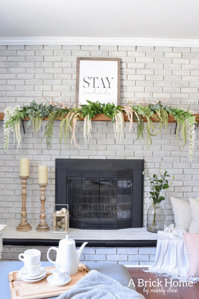spring fireplace mantel with cascading greenery
