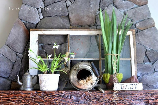 a collection of antique pieces mixed with fresh greenery for springtime mantel decor