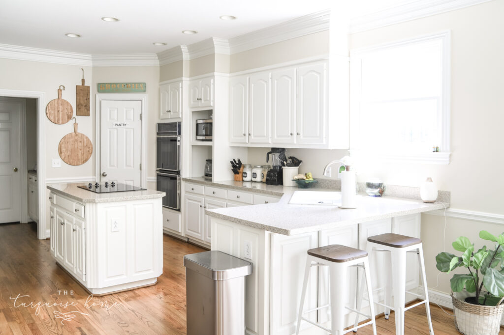 Traditional White Kitchen with Rich Hardwood Floors